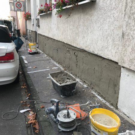 Sanierung Sockel an einem Wohn-Geschäftshaus in Mainz-Kostheim